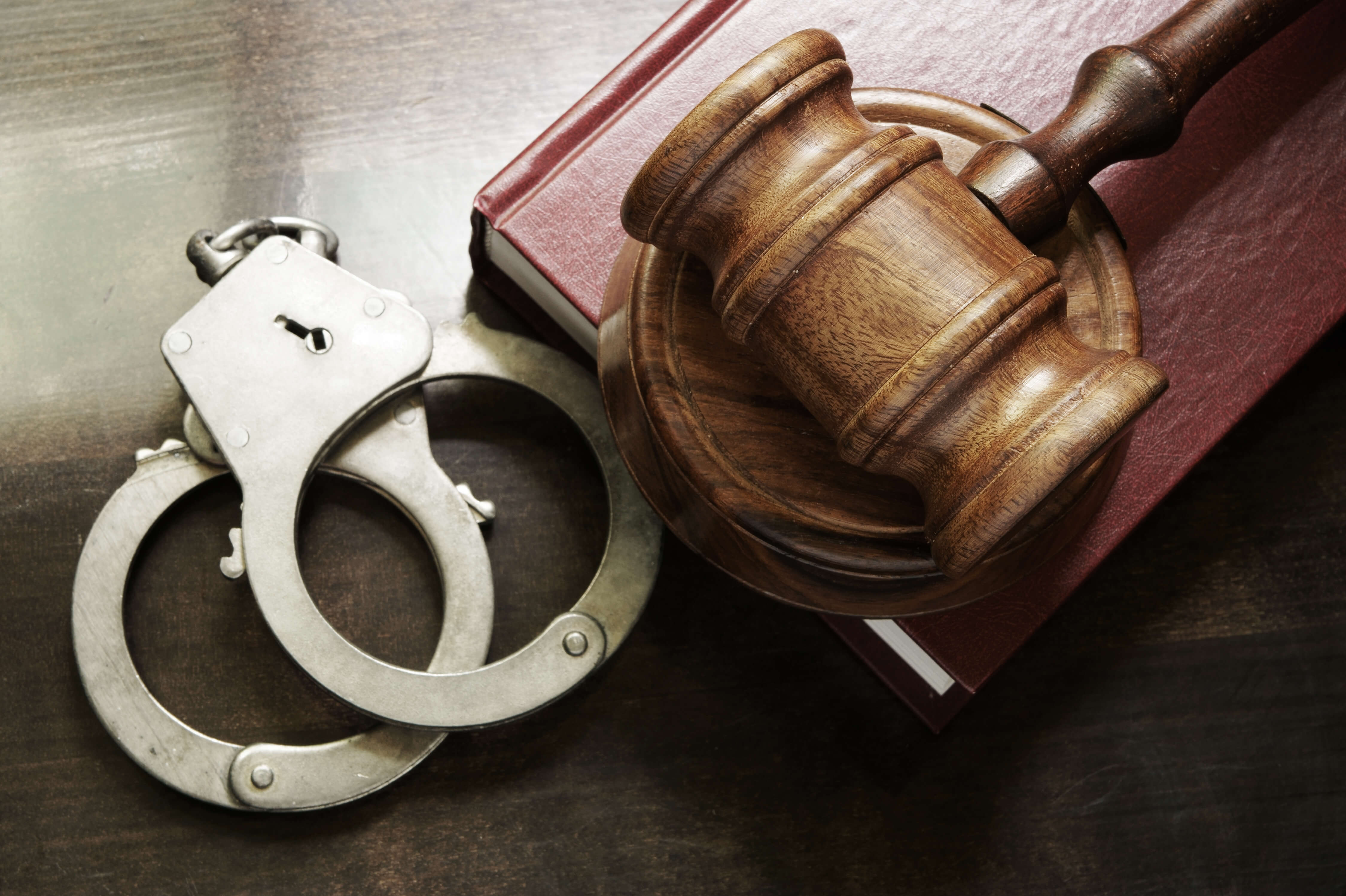 Gavel and handcuffs - post conviction relief attorney
